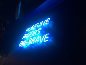 Fortune Favours the Brave. As seen in Times Square